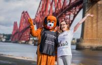 2 staff members standing in front of the Forth Bridge